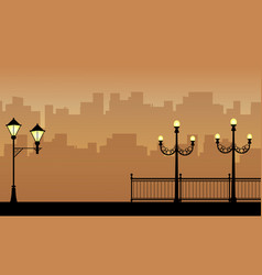Street lamp with city landscape silhouettes vector