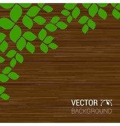 Green leaves on a wood texture season vector image