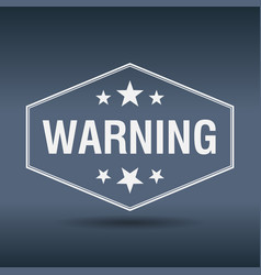 Warning hexagonal white vintage retro style label vector