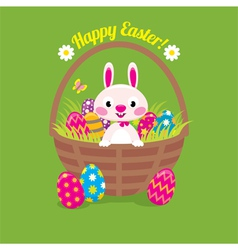 Easter bunny in a basket with easter eggs on a gre vector