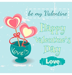 Two lollipop hearts in a vase vector