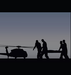 Soldiers with the wounded go to the helicopter vector