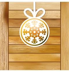 Christmas snowflake on a wood box EPS8 vector image vector image