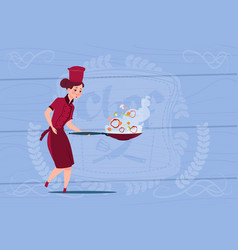 Female chef cook holding frying pan cartoon in vector