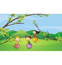 Happy kids playing with the bouncing balls vector image