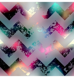 Grunge chevron pattern on blur background vector