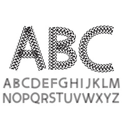 Alphabet letters made from motorcycle tire tracks vector