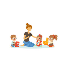 Group of preschool kids and teacher sit on carpet vector