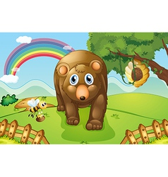 A big brown bear at the hills vector image vector image