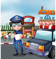 A policeman at a busy street vector image vector image