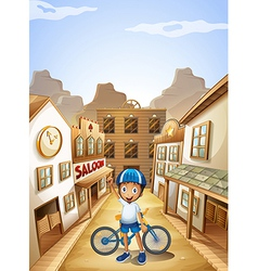 A boy and his bike near the saloon bar vector image vector image