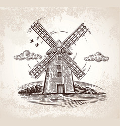 Windmill in rural landscape drawn by hand in a vector