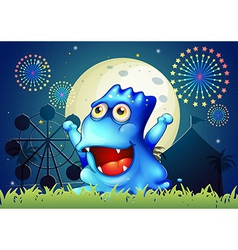 A blue monster strolling at the carnival in the vector image
