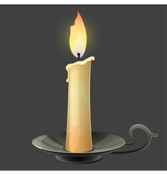 Burning candle in black metal candle holder vector