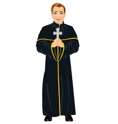 Young christian priest in cassock holding a cross vector