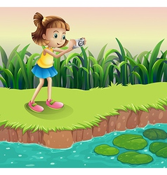 A girl taking photos at the pond vector