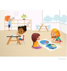 Multiracial children in montessori classroom vector