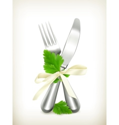 Table knife and fork with parsley icon vector image