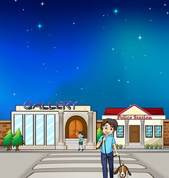 A young boy walking with his dog vector