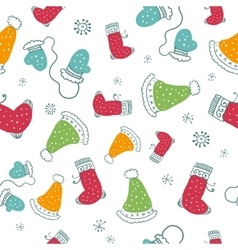 Seamless pattern with christmas socks mittens and vector