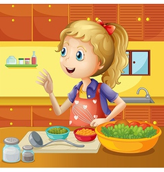 A young chef in the kitchen vector image