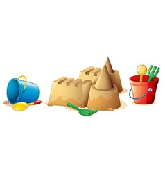 Beach toys and sand castle vector