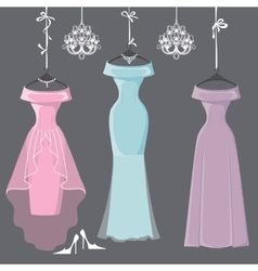 Three long bridesmaid dresses hang on ribbons vector