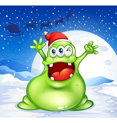 A fat green monster wearing a red Santa hat vector image