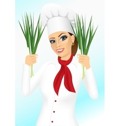 smiling female chef holding green onion vector image