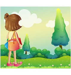 A girl with a bag at the hilltop vector