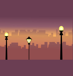 Silhouette of street lamp with city scenery vector