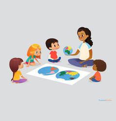 happy school kids and teacher sit in circle around vector image