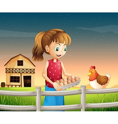 A woman holding an eggtray with eggs near the vector image vector image