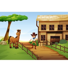 An angry cowboy with a horse at the fence vector