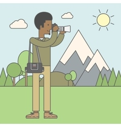 Photographer taking photo in mountains vector