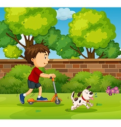 Boy riding on scooter in the yard vector