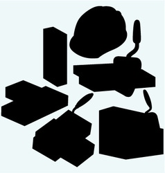 Trowel hard hat and bricks vector