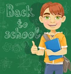 Teenage boy with a textbook near blackboard vector image