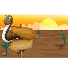 Snake in the desert near the signboard vector image