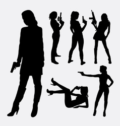 Female with gun silhouettes vector