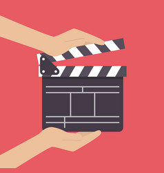 Hands holding movie clapper vector