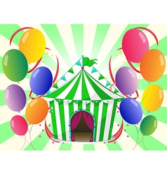 A green circus tent at the center of the colorful vector image vector image