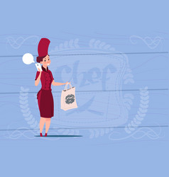 Female chef cook holding bag with food restaurant vector