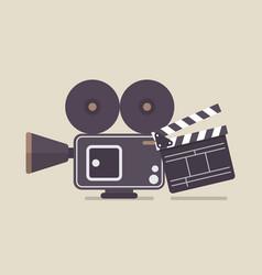 Retro movie camera and movie clapper vector