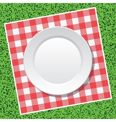 Tablecloth and empty plate vector