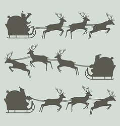 Silhouettes of santa claus on his sleigh vector