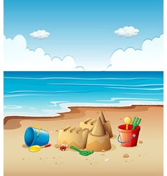 Ocean scene with toys on the beach vector