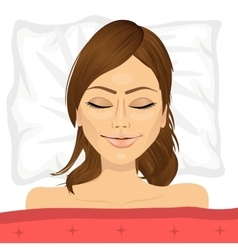 Young brunette woman sleeping in bed at home vector