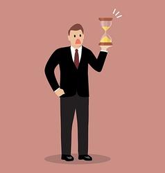 Businessman holding sandglass vector image