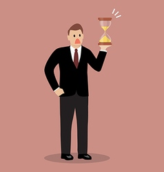 Businessman holding sandglass vector image